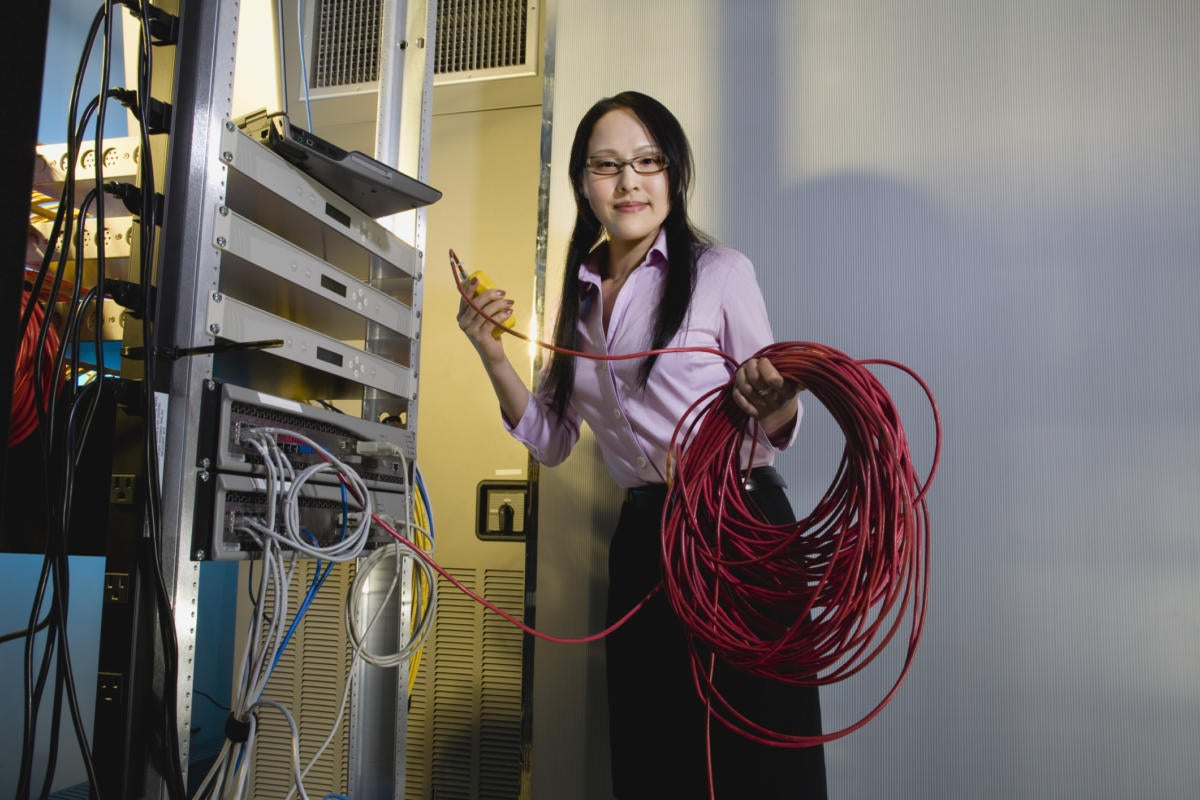 female worker server room data center