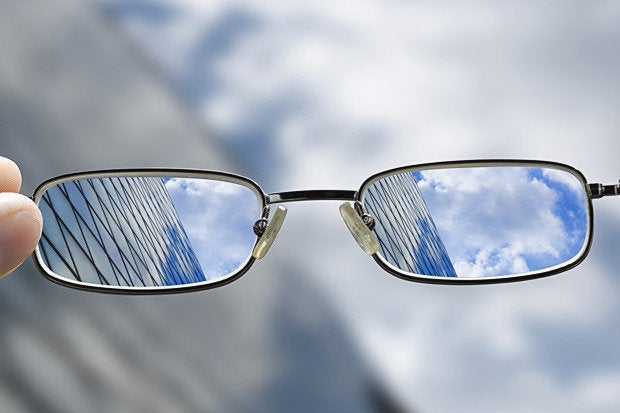 glasses focus clouds buildings