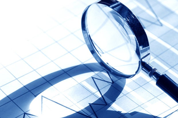 magnifying glass on business chart