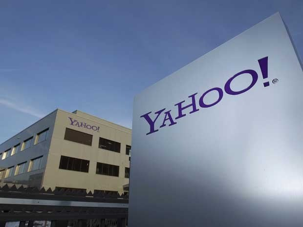 A Yahoo logo is pictured in front of a building.