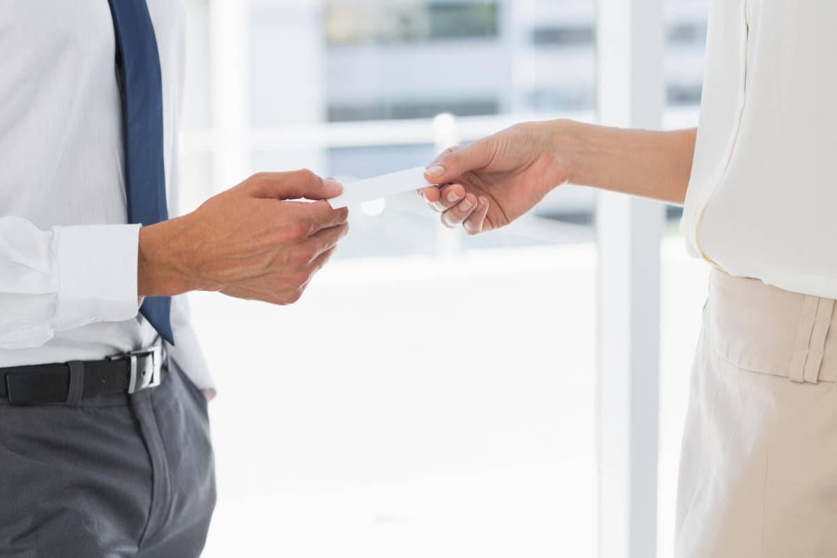 business men passing card thinkstock