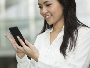 Business woman using smartphone.
