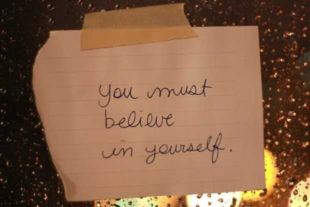 A handwritten sign that says You must believe in yourself.