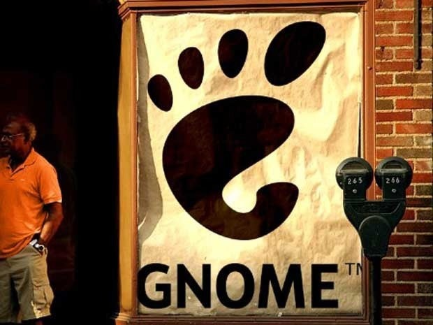 A poster with the GNOME name and logo on the side of a building.