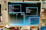 A computer desktop with the word Python screens monitors code coding