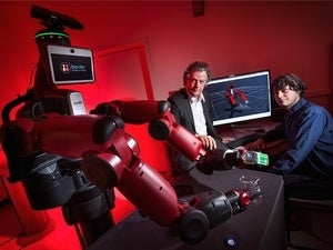 Yiannis Aloimonos (center) led a team that programmed robots to learn by watching YouTube.