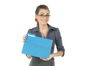 woman holding resumes