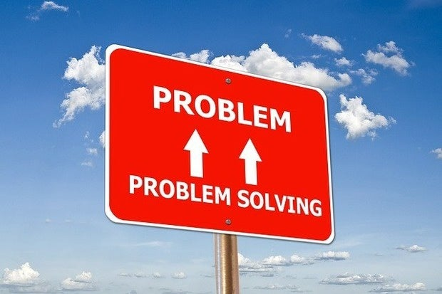 problem solving road sign arrows pointing