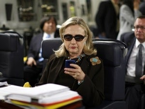 030415blog hillary clinton checks her email