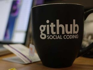 A mug with the words GitHub Social Coding