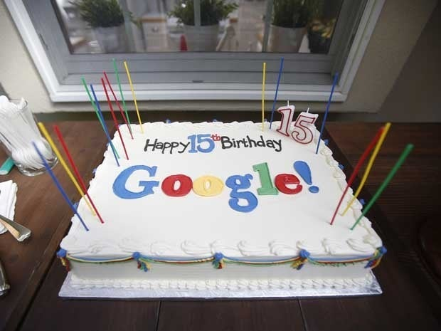 A cake with the words Happy 15th birthday Google! written in icing