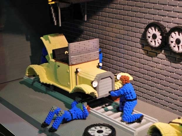 Mechanics working on a car rendered in LEGOs