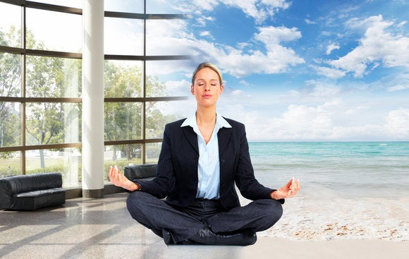 Female executive meditating in office and on beach