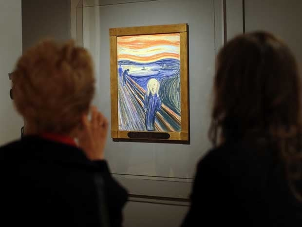 Two women view Edvard Munch's painting