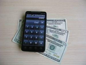 Older Android smartphone with cash