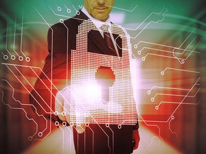 Business man touching a futuristic lock and circuit board interface.