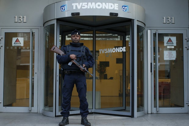 A French police officer stands guard at French television network TV5Monde.