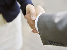 handshake businesswoman businessman stock