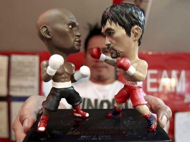 Miniature figurines of boxers Floyd Mayweather Jr. and Manny Pacquiao