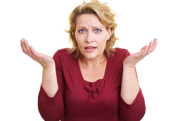 shrugging woman