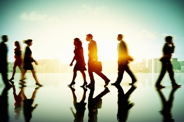 group of executives walking in open building