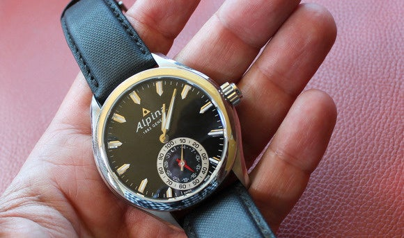 swiss smartwatch alpina in hand