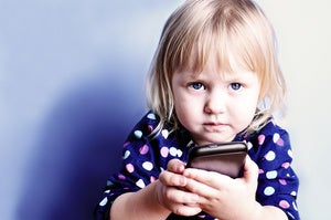 child holding cell phone baby