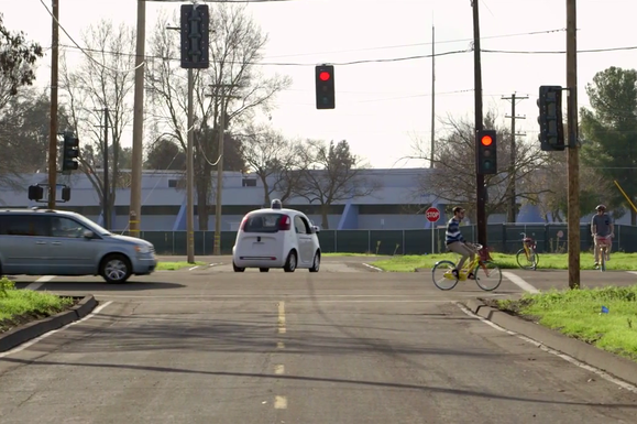 google self driving car no driver on road car bicyclists may15 2015 17