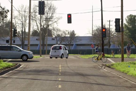 google self driving car no driver on road car bicyclists may15 2015 17