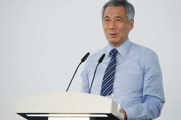 Singapore's Prime Minister Lee Hsien Loong speaking at a podium