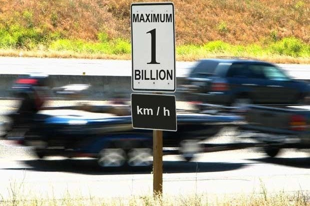 A road sign that says Maximum 1 Billion km/h