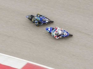 Two motorcycle racers on a track