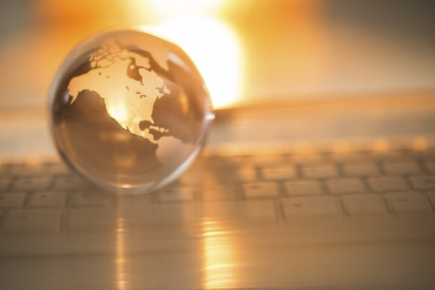 crystal globe displaying the united states of america on a keyboard