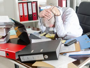 messy cio desk worker office frustration