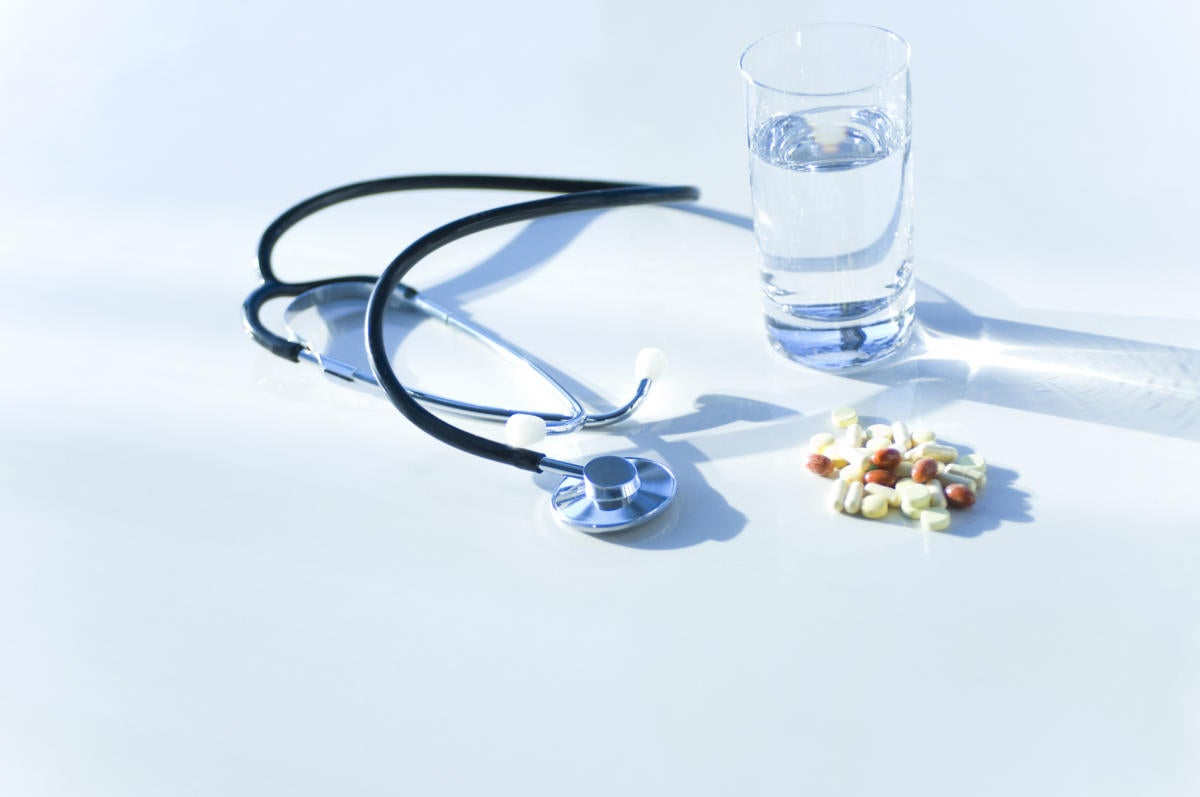 stethoscope with pills and healthcare items