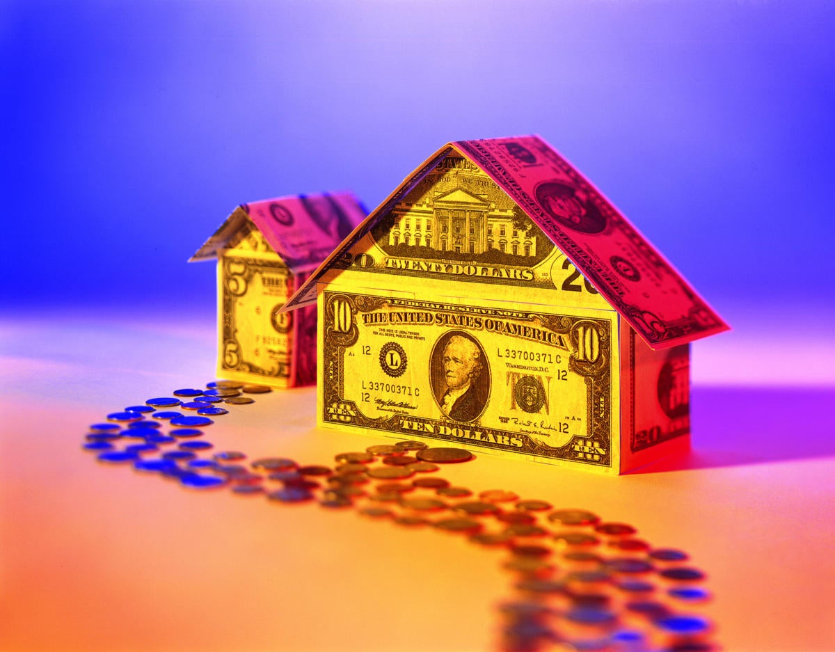 high contrast image of house made out of money as investment or money pit