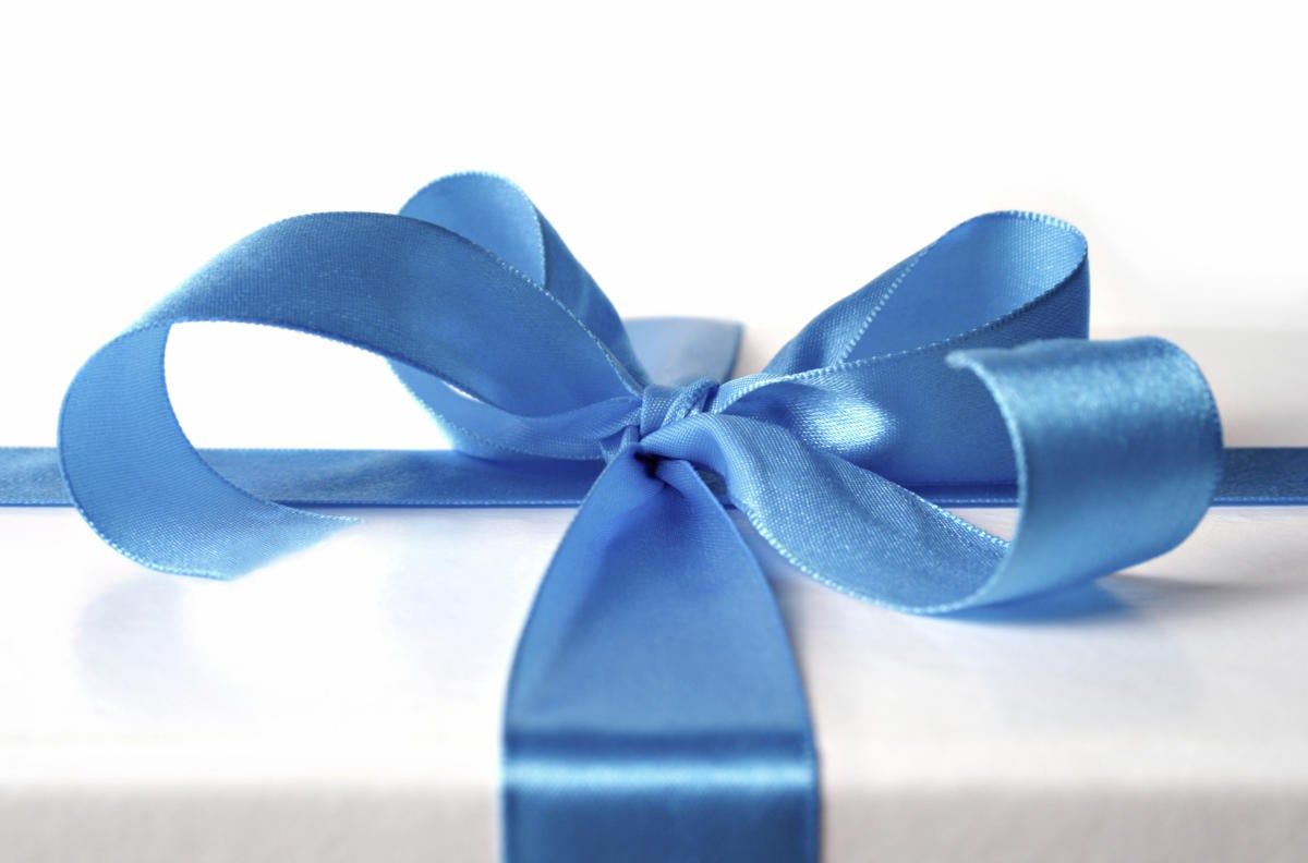 white gift box with blue ribbon