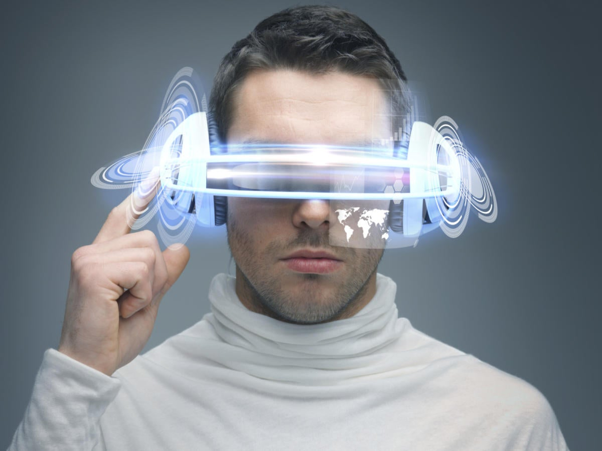 futuristic guy wearing virtual reality glasses