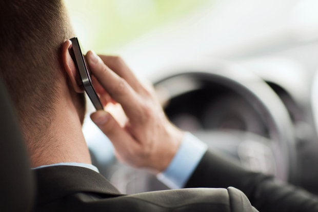 guy driving talking on phone