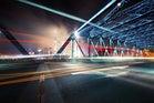 futuristic city with bridge in motion