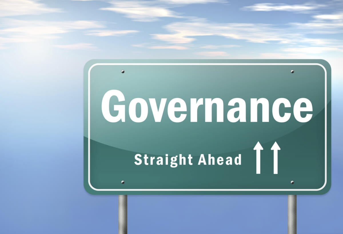 Road sign with the word Governance on it