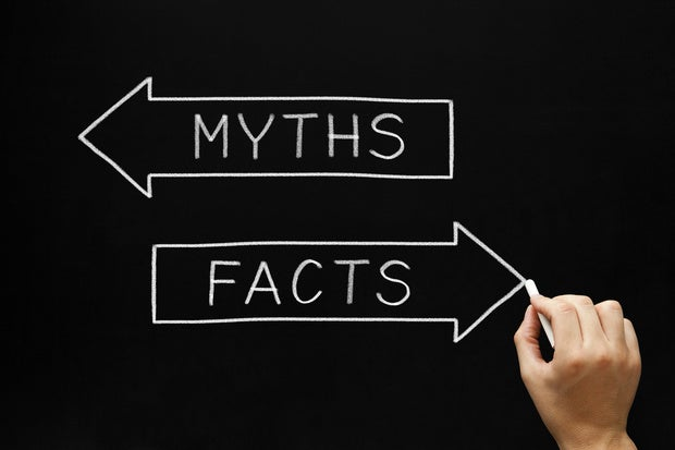 hand writing on chalkboard showing myth vs fact