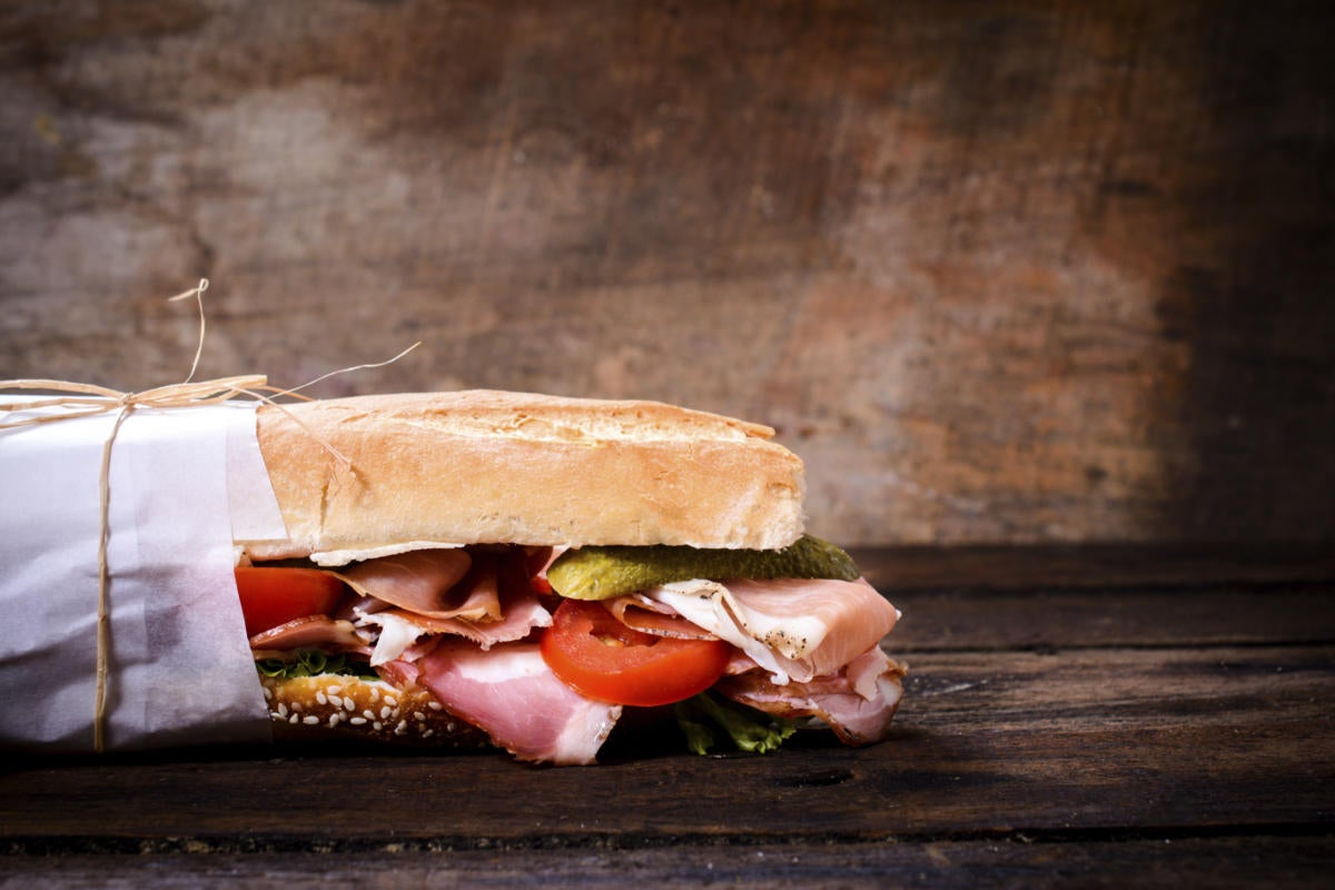 Submarine sandwich on rustic background