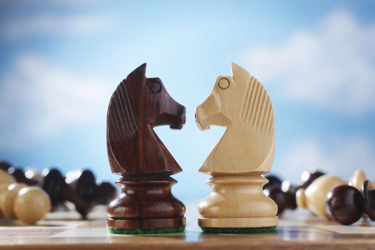 2 chess pieces facing off