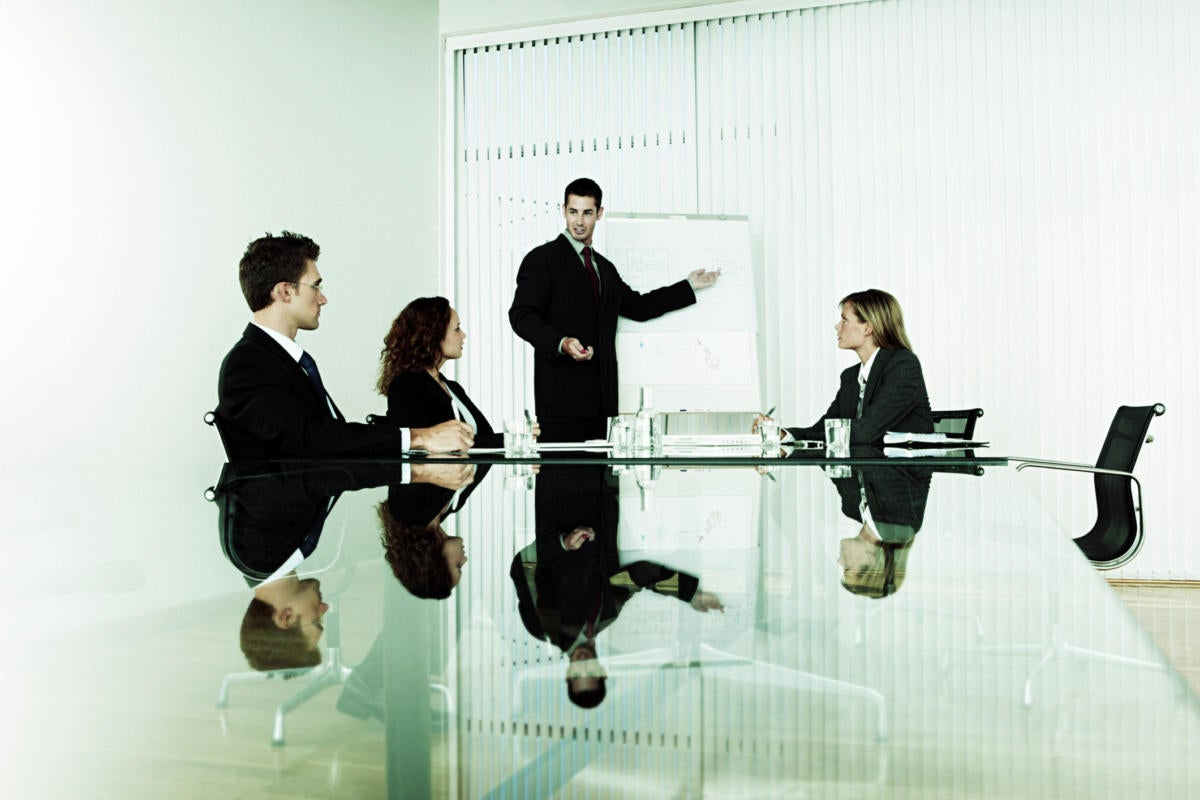 young executive standing at white board in conference room