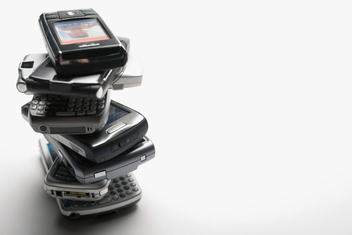 outdated stack of cell phones and mobile devices