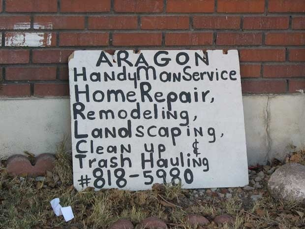 A hand painted sign advertising a handy man's variety of services