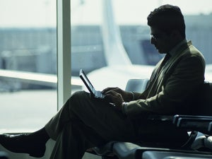 laptop business airport checking email