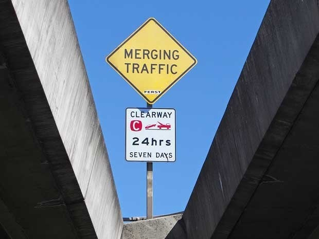 A street sign that says Merging Traffic