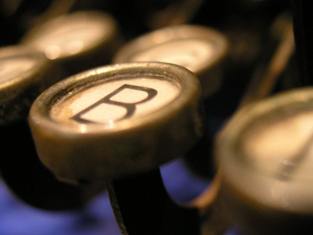 closeup of retro typewriter key with the letter B for blog